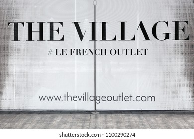 Villefontaine, France - May 24, 2018: The village logo on wall. The Village is a French outlet village opened since May 18, 2018, in Villefontaine in the department of Isere near Lyon
