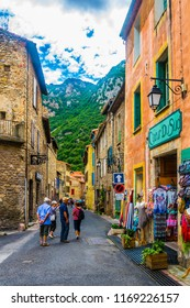 VILLEFRANCHE DE CONFLENT, FRANCE, JUNE 27, 2017: People are strolling through a narrow street in the center of Villefranche de Conflent, France
