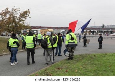 Villefranche en Beaujolais, France - November 19, 2018: Yellow vests protest against higher fuel prices and block motorway in Villefranche en Beaujolais, France