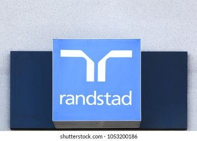 Villefranche, France - March 14, 2018: Randstad logo on a wall. Randstad is a Dutch multinational human resource consulting firm headquartered in Diemen, Netherlands