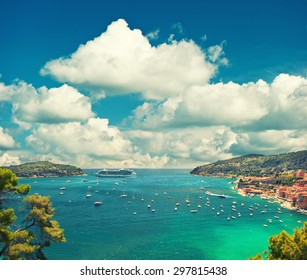Villefranche, Provence, french riviera, Mediterranean Sea. View of luxury resort and bay of Cote d Azur. Vintage style toned picture