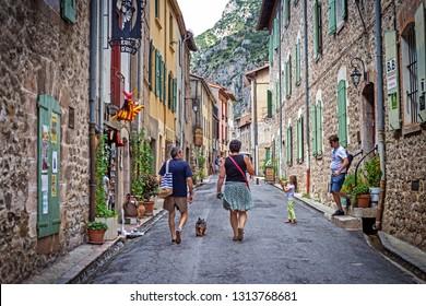 VILLEFRANCHE-DE-CONFLENT, FRANCE - 14 Aug 2018: Narrow cozy streets of medieval picturesque town of Villefranche-de-Conflent, Occitanie, in the Pyrénées-Orientales department in southern France