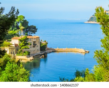VILLEFRANCHE-SUR-MER, FRANCE - MAY 8, 2013: Villa in the small bay on the bank of the Mediterranean Sea. Landscape of the Cote d'Azur, Villefranche-sur-Mer, France