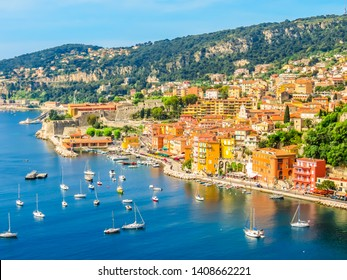 VILLEFRANCHE-SUR-MER, FRANCE - MAY 8, 2013: Fishing boats and yachts in the Villefranche-sur-Mer bay. Landscape of the Cote d'Azur, Villefranche-sur-Mer, France