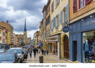 Villefranche-sur-Saone, France - May 04, 2019: Scene of main street and the church of Notre-Dame des Marais, with locals and visitors, in Villefranche-sur-Saone, Beaujolais, Rhone department, France