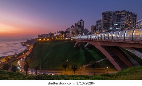 Villena Bridge with traffic and partial City view in the Background day to night transition view, Lima, Peru. Aerial view with illuminated coastline and Love park