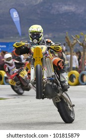VILLENA, SPAIN - MAY 29: An unidentified pilot pulls a wheelie at in the Spanish championship of supermotard on May 29, 2012, Villena Spain