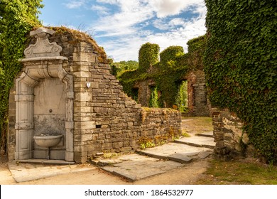 Villers-La-Ville, Belgium - August 19 2020: Ruins of the medieval abbey. fountain