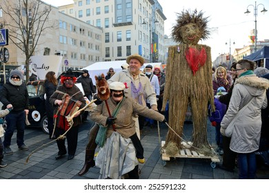 VILNIUS - FEBRUARY 14: Unidentified peoples in traditional masks on February 14, 2015 in Vilnius, Lithuania. Uzgavenes is a Lithuanian folk festival that start during the seventh week before Easter.