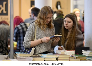 VILNIUS - FEBRUARY 26: people choose books at the indoor book market on February 26, 2016 in Vilnius, Lithuania. Vilnius is the capital of Lithuania and its largest city.