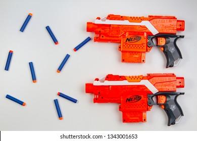 Vilnius, Lithuaania - March 5, 2019: Nerf N-Strike Elite Stryfe Blaster and Refill Bullet Darts on white background