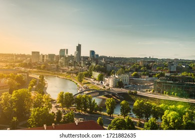 VILNIUS, LITHUANIA- 10 JUNE 2019: Beautiful and bright  view from top of the hill of Gediminas' Tower on Vilnia river and old Vilnius center, Vilnius Lithuania.