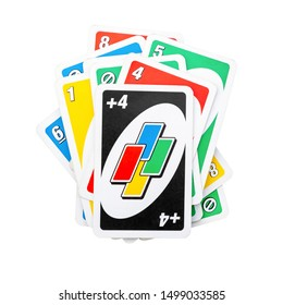 VILNIUS, LITHUANIA - 8 SEPTEMBER, 2019: Pile of Uno game cards isolated on white background, front view flat lay picture