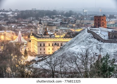 Vilnius, Lithuania: aerial view of the old town,  christmas tree and decorations in Cathedral Square at sunset