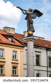 Vilnius, Lithuania - April 10, 2021: Uzupis Angel sculpture (sculptor Romas Vilciauskas) was placed in the central square of Uzupis district in 2002. It has become the symbol of Uzupis.