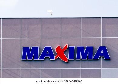 Vilnius, Lithuania- April 12, 2018: MAXIMA store logo. Maxima is a retail chain operating food tores in Lithuania, Latvia, Estonia, Bulgaria, and Poland.