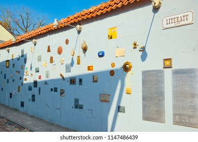 Vilnius, Lithuania - April 12, 2018: Literary Street is one of the oldest streets in Vilnius Old Town, Lithuania. Wall of literary works of art.