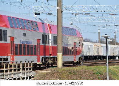 Vilnius, Lithuania - April 18: Lithuanian Railways Running train in Vilnius on April 18, 2019. Lithuanian Railways is the national railway company of the country