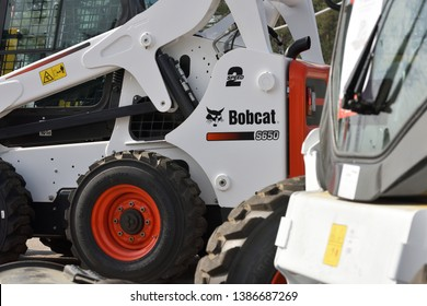 Vilnius, Lithuania - April 25: Bobcat heavy duty equipment vehicle and logo on April 25, 2019 in Vilnius Lithuania. Bobcat Company is an American-based manufacturer of farm and construction equipment.