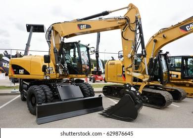 VILNIUS, LITHUANIA - APRIL 27: Caterpillar M313D Mobile Excavator on April 27, 2017 in Vilnius, Lithuania. Caterpillar is a leading manufacturer of construction equipment.