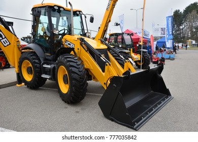 VILNIUS, LITHUANIA - APRIL 27: JCB heavy duty equipment vehicle and logo on April 27, 2017 in Vilnius, Lithuania. JCB corporation is manufacturing equipment for construction and agriculture.