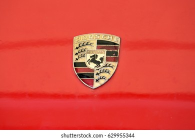 VILNIUS, LITHUANIA - APRIL 27: old and scratched Porsche sign close up on the car front on April 27, 2017 in Vilnius, Lithuania. F. Porsche founded the company in 1931 in the Stuttgart