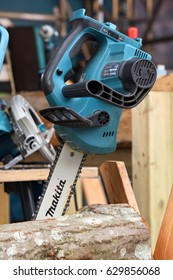VILNIUS, LITHUANIA - APRIL 27: Professional electric Makita brand chainsaw on April 27, 2017 in Vilnius, Lithuania. Makita Corporation founded on March 21, 1915, it is based in Japan.