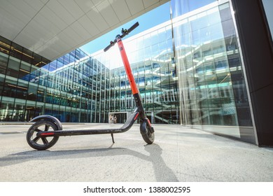 VILNIUS, LITHUANIA - APRIL 28, 2019: Electric scooter CityBee with office building in background