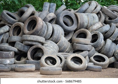 VILNIUS, LITHUANIA - AUG 7, 2016: Pile of used rubber tyres. Tire recycling is the process of recycling vehicles tires that are no longer suitable for use on vehicles due to wear or irreparable damage
