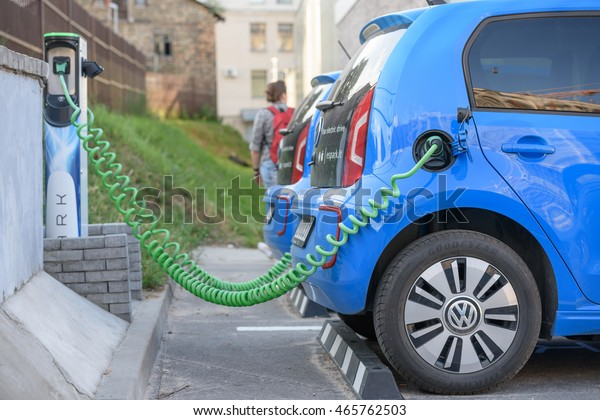 VILNIUS, LITHUANIA - AUGUST 05, 2016:  Electric car Volkswagen e-Up charging its batteries on a parking. Spark car sharing service in Lithuania.