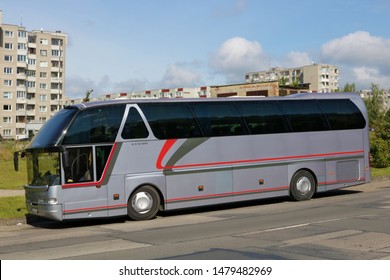 VILNIUS, LITHUANIA - AUGUST 10, 2019: A silver Neoplan N516SHD bus is parked at the side of the road on Smalines Street in the residential area  Pilaite.