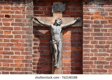 Vilnius, Lithuania - August 19, 2017: Crucifixion of Jesus Christ on brick wall of Catholic Church st. Anne in Vilnius