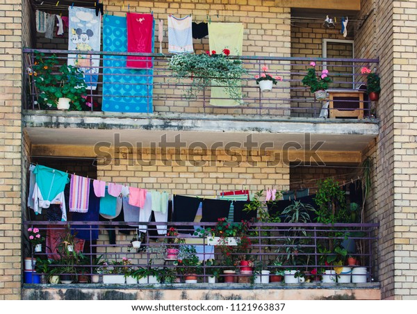 Vilnius, Lithuania - August 20, 2016: Balconies of some Vilnius apartaments with laundrylines and flower pots.