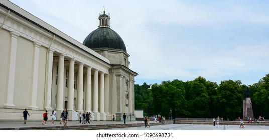 Vilnius, Lithuania - August 3, 2017: Tourists walking at the Cathedral Square. Vilnius Cathedral -  Roman Catholic church built in 1779-1783, one of the main touristic points of Vilnius