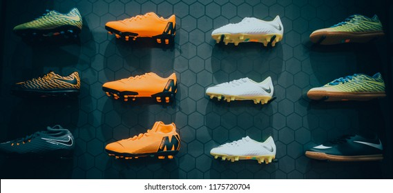 Vilnius, Lithuania - August 30, 2018: Nike football boots displayed on black background in sport store