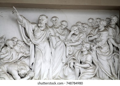VILNIUS, LITHUANIA - AUGUST 7, 2016: Relief composition of Vilnius Cathedral, depicting the Healing of the Lame Man (Peter Heals a Lame Beggar) by Tommaso Righi
