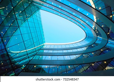 Vilnius, Lithuania - August 8, 2017: Details of futuristic architecture of steel and glass skyscraper reflecting the blue sky