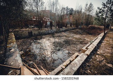 VILNIUS, LITHUANIA - DECEMBER 02, 2019: The ruins of abandoned sanitarium near Vilnius city. The view of abandoned pool.
