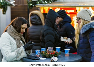 Vilnius, Lithuania - December 3, 2016: People at Christmas market on the Cathedral Square in Vilnius,  Lithuania