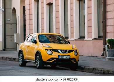 Vilnius, Lithuania, Eastern Europe - July 7, 2016: Yellow Color Car Nissan Juke Parked In Street In European Town. Nissan Juke Is Subcompact Crossover SUV Produced By The Japanese Manufacturer Nissan