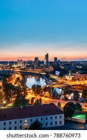 Vilnius, Lithuania, Eastern Europe - July 5, 2016: Sunset Cityscape. Modern Office Buildings Skyscrapers In Business District New City Center Shnipishkes In Night Illuminations.