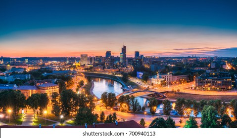 Vilnius, Lithuania, Eastern Europe. Modern Office Buildings Skyscrapers In Business District New City Center Shnipishkes In Night Illuminations. Panoramic View Cityscape At Sunset.