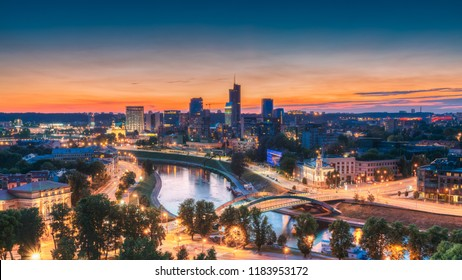 Vilnius, Lithuania, Eastern Europe. Summer Cityscape With Modern Office Buildings Skyscrapers In Business District New City Center Shnipishkes In Night Illuminations During Sunset.