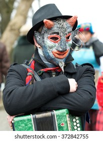 VILNIUS, LITHUANIA - FEB 7: musician playing in annual traditional lithuanian festival Uzgavenes, carnival in lithuanian style on feb 7, 2016 in Vilnius, Lithuania. Street musician in mask