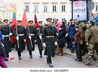 VILNIUS, LITHUANIA - FEBRUARY 16, 2017: Celebration of the independence of Lithuania. Lithuanian Armed Forces Officers  with respect bears a festive state and historical  flags