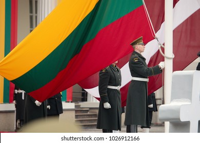 Vilnius, Lithuania - February 16, 2018:  Raising the flags of the three Baltic States  during a state ceremony to mark the 100th anniversary of the restoration of Lithuanian statehood.
