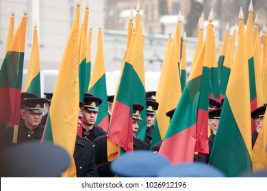 Vilnius, Lithuania - February 16, 2018:  Military parade and the collonade of 100 Lithuanian flags during a state ceremony to mark the 100th anniversary of the restoration of Lithuanian statehood.