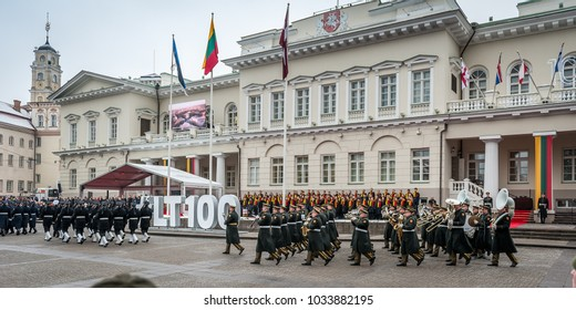 Vilnius, Lithuania - February 16, 2018: Ceremony of hoisting the flags of the three Baltic States held in the Independence Square to mark the Day of Lithuania's Independence. Panoramic view.