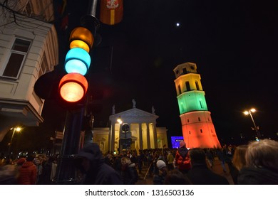 Vilnius, Lithuania - February 16 2019:  The Belfry of the Cathedral Illuminated by the Colors of Lithuanian Flag
