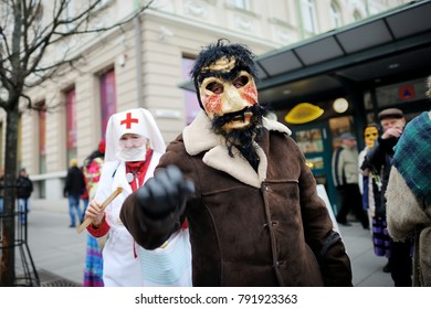 VILNIUS, LITHUANIA - FEBRUARY 25, 2017: Hundreds of people celebrating Uzgavenes, a Lithuanian annual folk festival taking place before Easter. Participants wearing traditional masks and costumes.